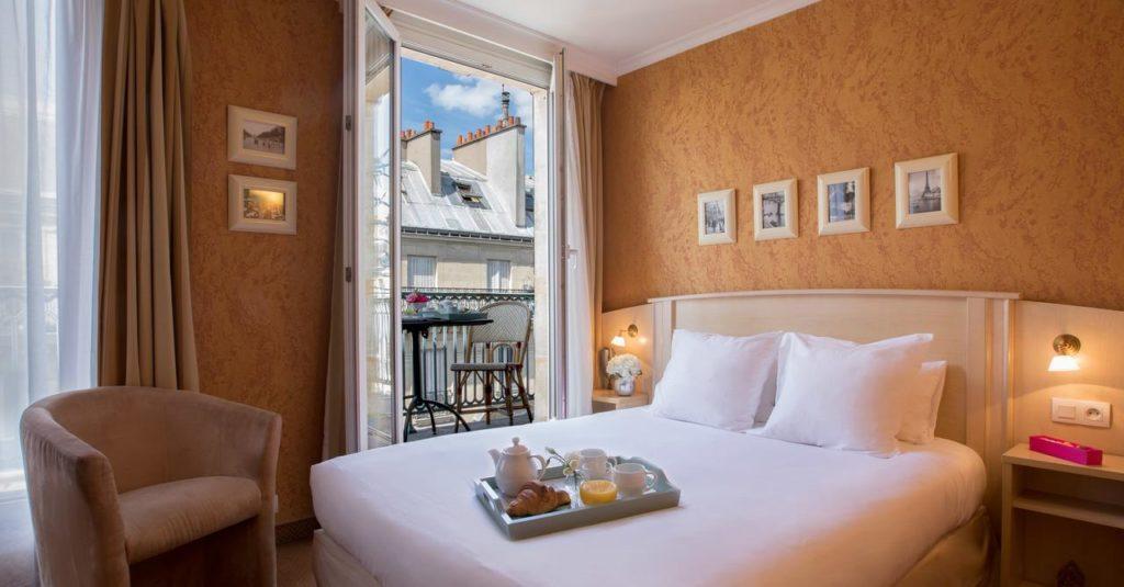 Quarto do Hotel Elysees Opera - super aconchegante - Foto: Divulgação