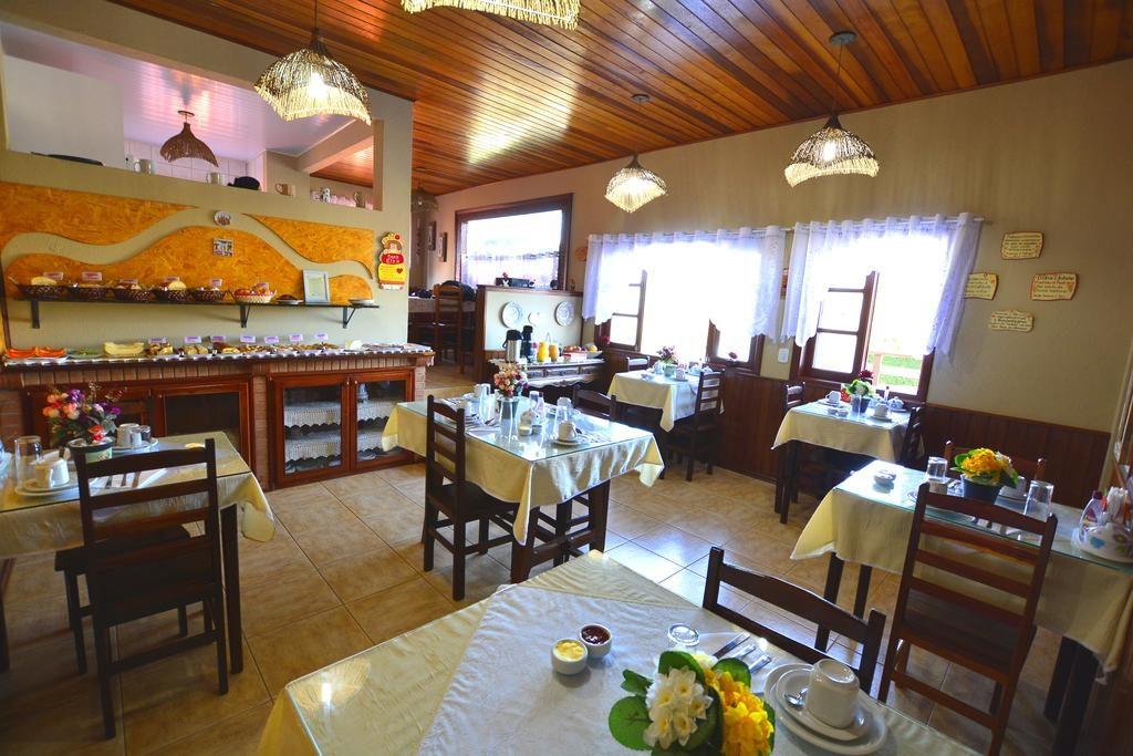 área do café da manhã da Pousada Cantinho de Monte Verde
