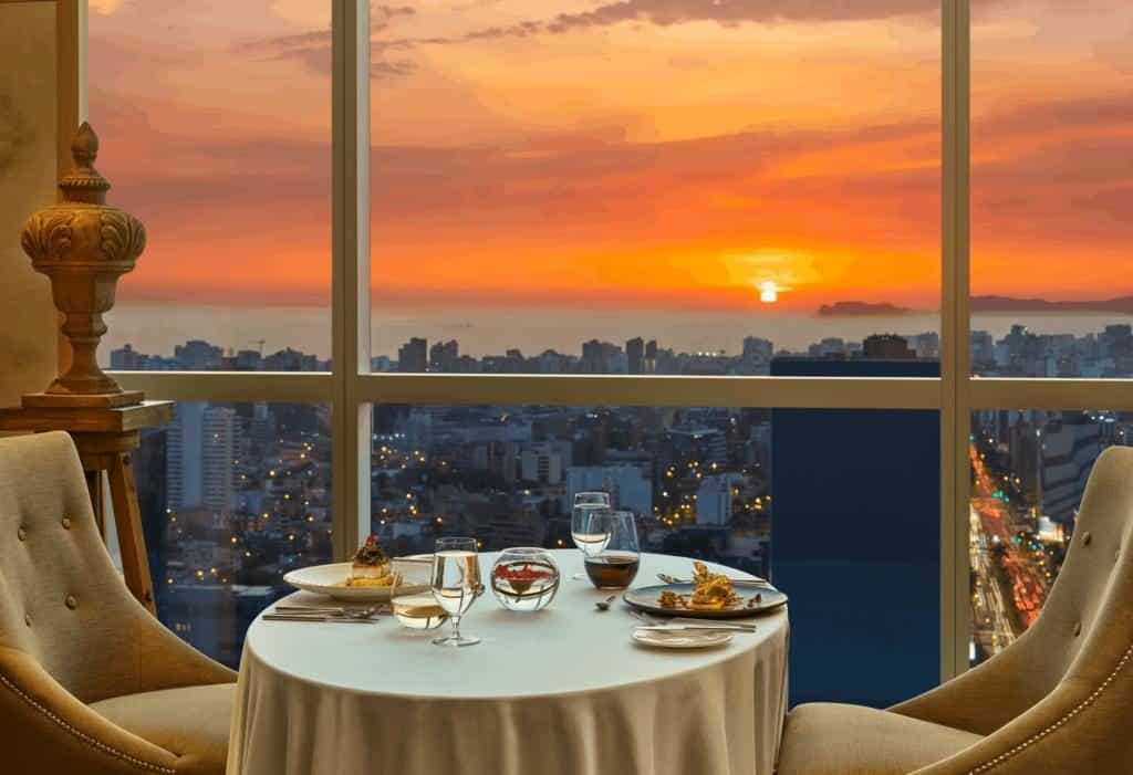 Mesa de jantar no restaurante do The Westin com vista para o pôr do sol na cidade de Lima