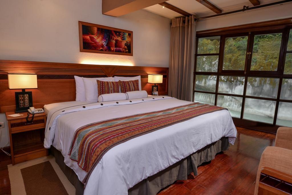Cama super espaçosa no Casa del Sol, um dos melhores hoteis de Machu Picchu