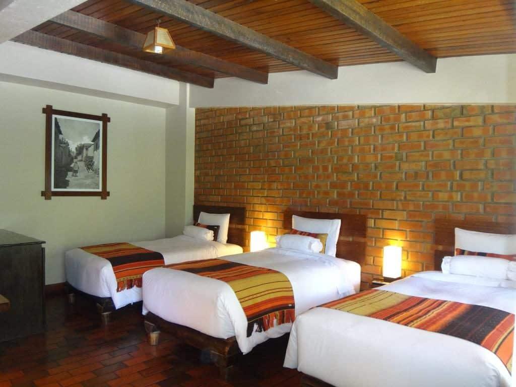 Foto de quarto triplo no Panorama B&B. um dos melhores hoteis em Machu Picchu