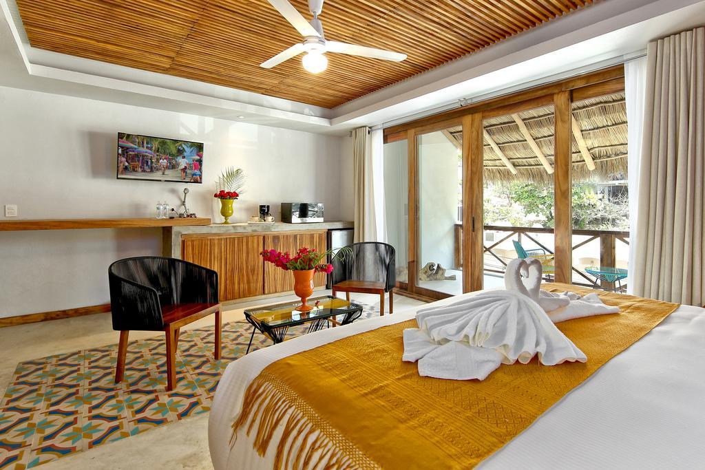 O lindo quarto de casal no Hotel Boutique OZ Sayulit