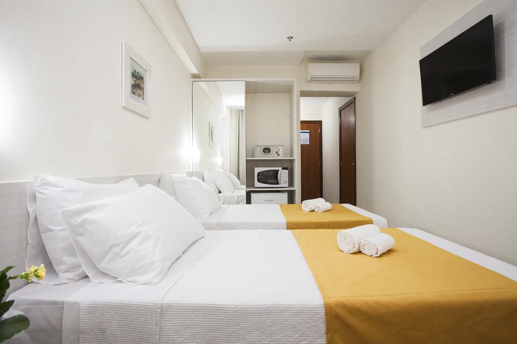 green hoteis quarto