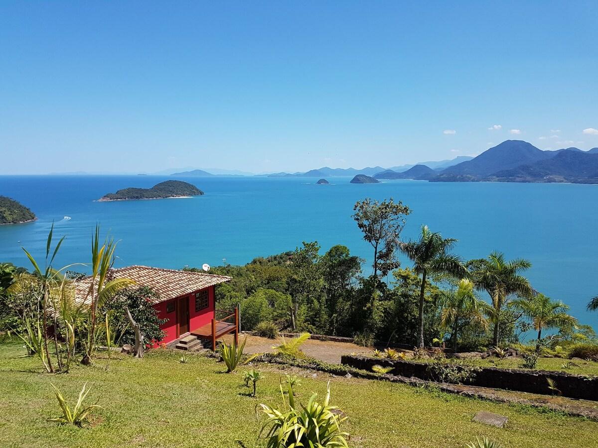 Vista da Praia da Almada a partir de Airbnb Casinha Vermelha