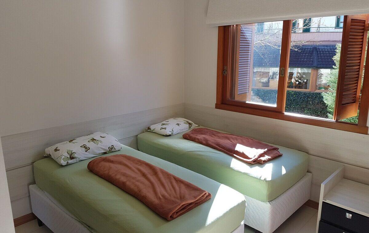 quarto do Lindo Apartamento Próximo a Rua Coberta em Gramado