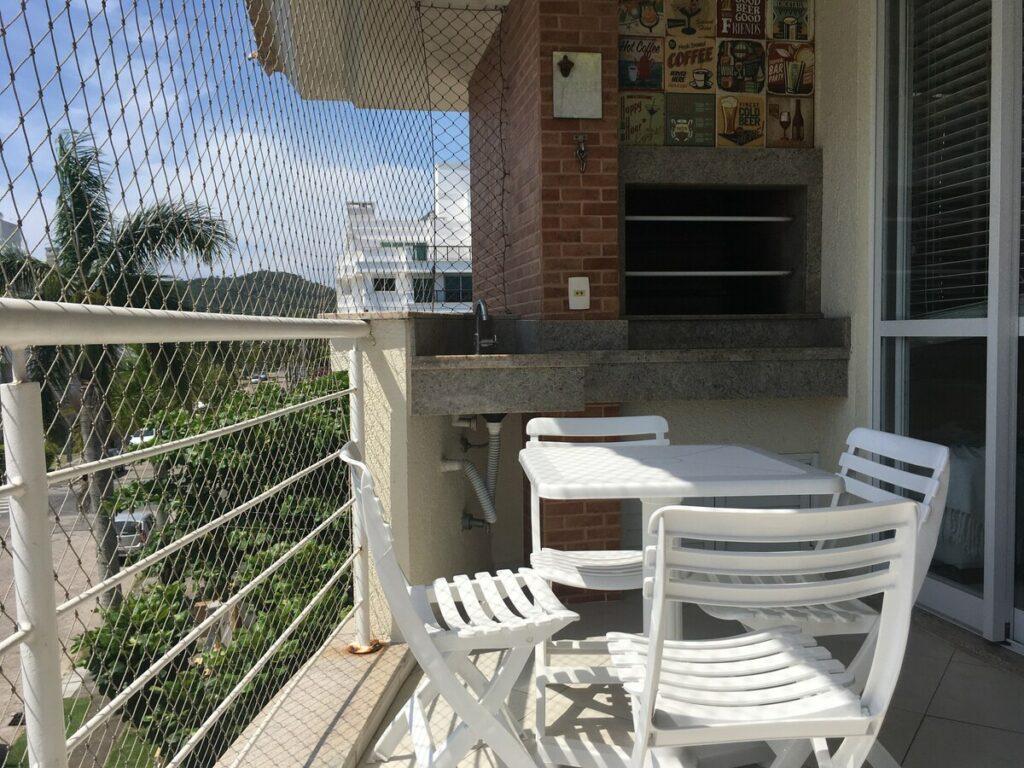 varanda do airbnb Condomínio Aconchegante em jurerê internacional