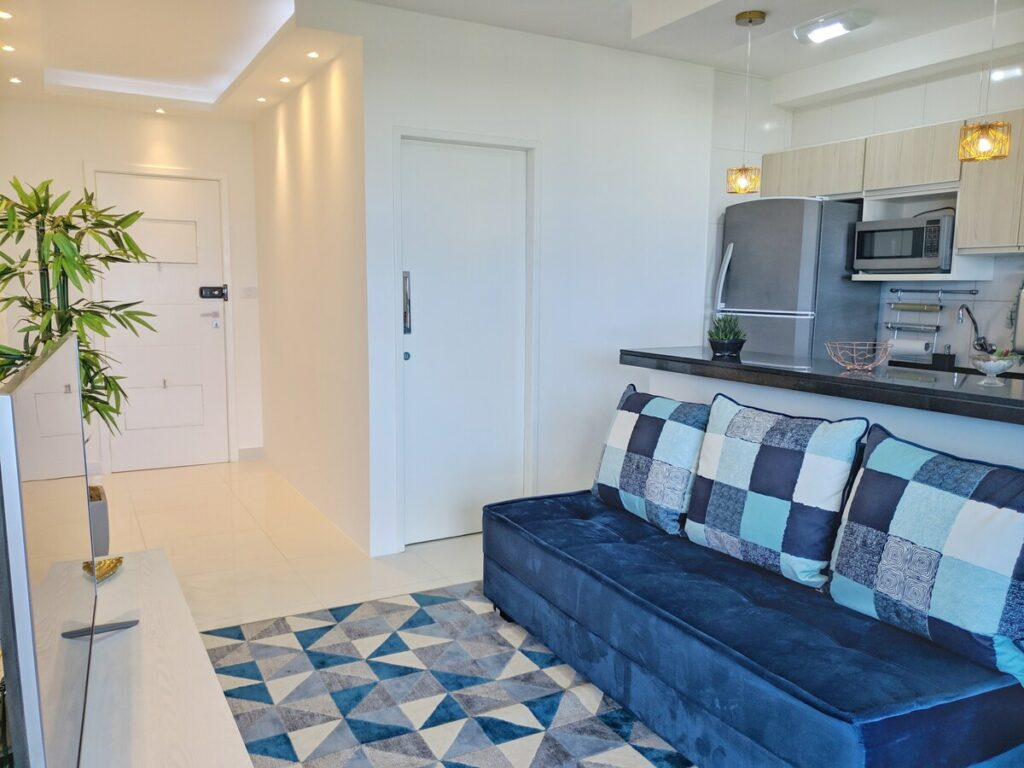 sala e cozinha do Lindo Apartamento com Vista para o Mar na Orla de Atalaia