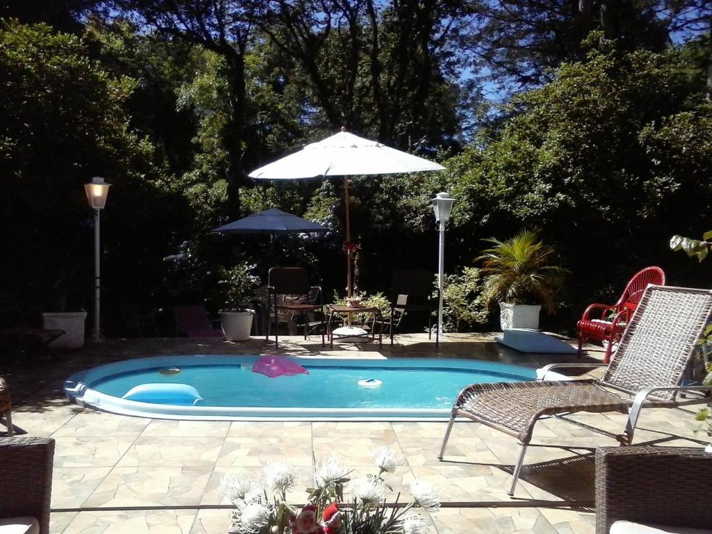 piscina da Nanda's House Pousada em São Francisco de Paula