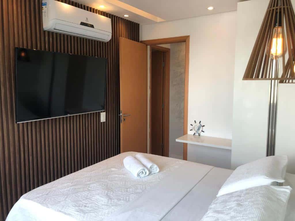 quarto do Palm Acqua Resort nos hotéis em muro alto