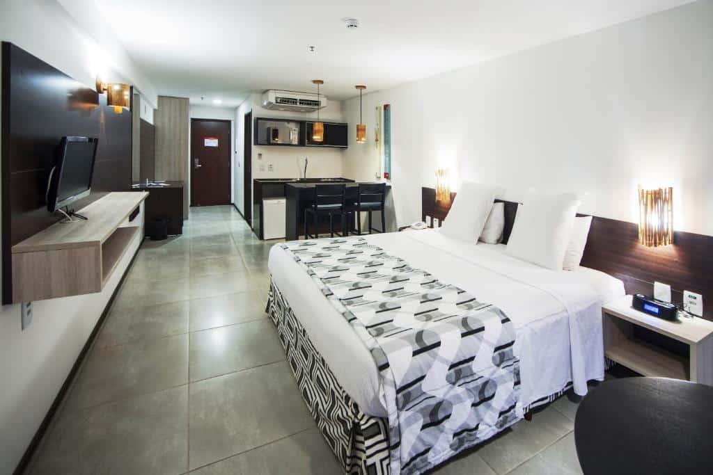 quarto do Ritz Suites Home Service